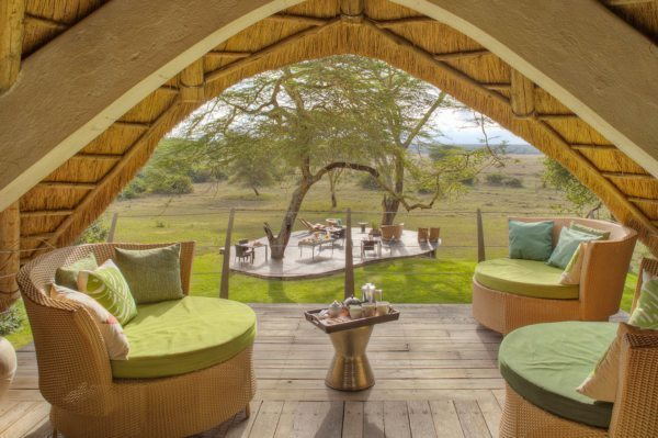 The upstairs guest area at Solio Lodge overlooks the outdoor dining area, and the conservancy beyond.
