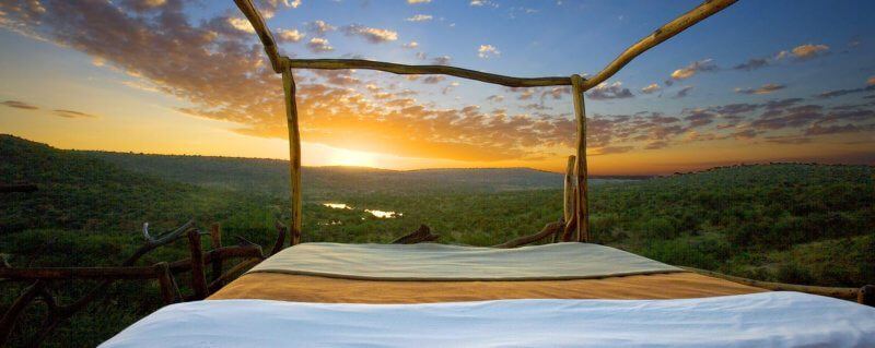 You'll see the most spectacular sunrise right from your four-poster when staying at Loisaba Star Beds.