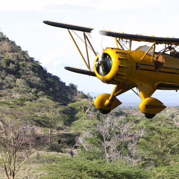 A ride over Kenya in a biplane lets you appreciate the wilderness from above.