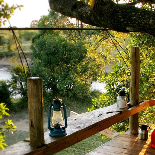 A Masai Mara treehouse deck affords spectacular views over the Mara River..