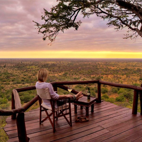 Wash down the sunset with a chilled glass of wine on your private cottage deck at Elsa's Kopje Meru. © Elewana Collection