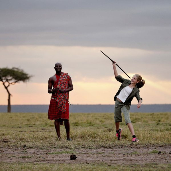 You can try your hand at throwing a spear during Maasai cultural visits. © Elewana Collection