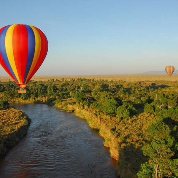 Crossing the Mara River in a hot-air balloon is a thrilling experience. © Angama Mara