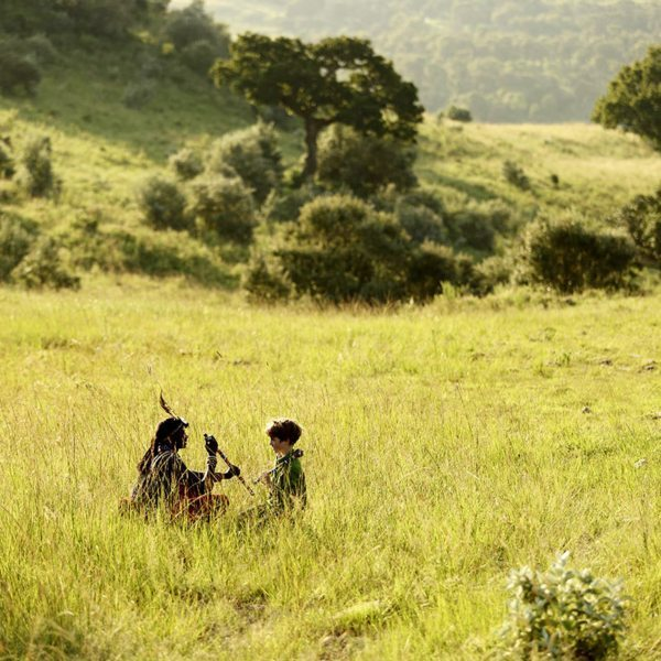 Young boys will love spending time with real Maasai warriors, and learning some of their skills. © Angama Mara