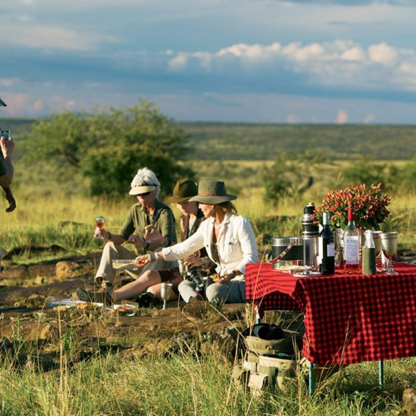 Sundowners with Mara Plains Camp in the Masai Mara combines luxury with wilderness. © Great Plains Conservation