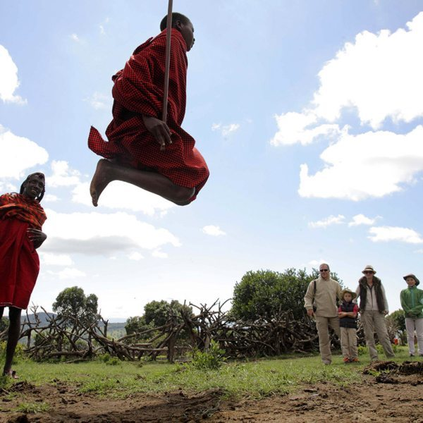 While jumping in the traditional 'jumping dance', the Maasai never let their heels touch the ground. © &Beyond