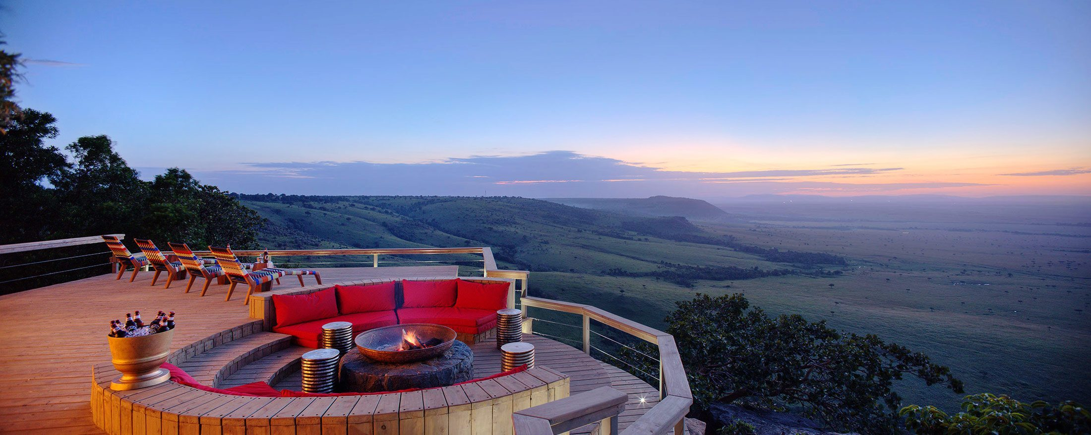 Luxury Kenya safari   The fire pit at Angama Mara, perched high above the Great Rift Valley, is perfectly positioned for sundowner drinks.
