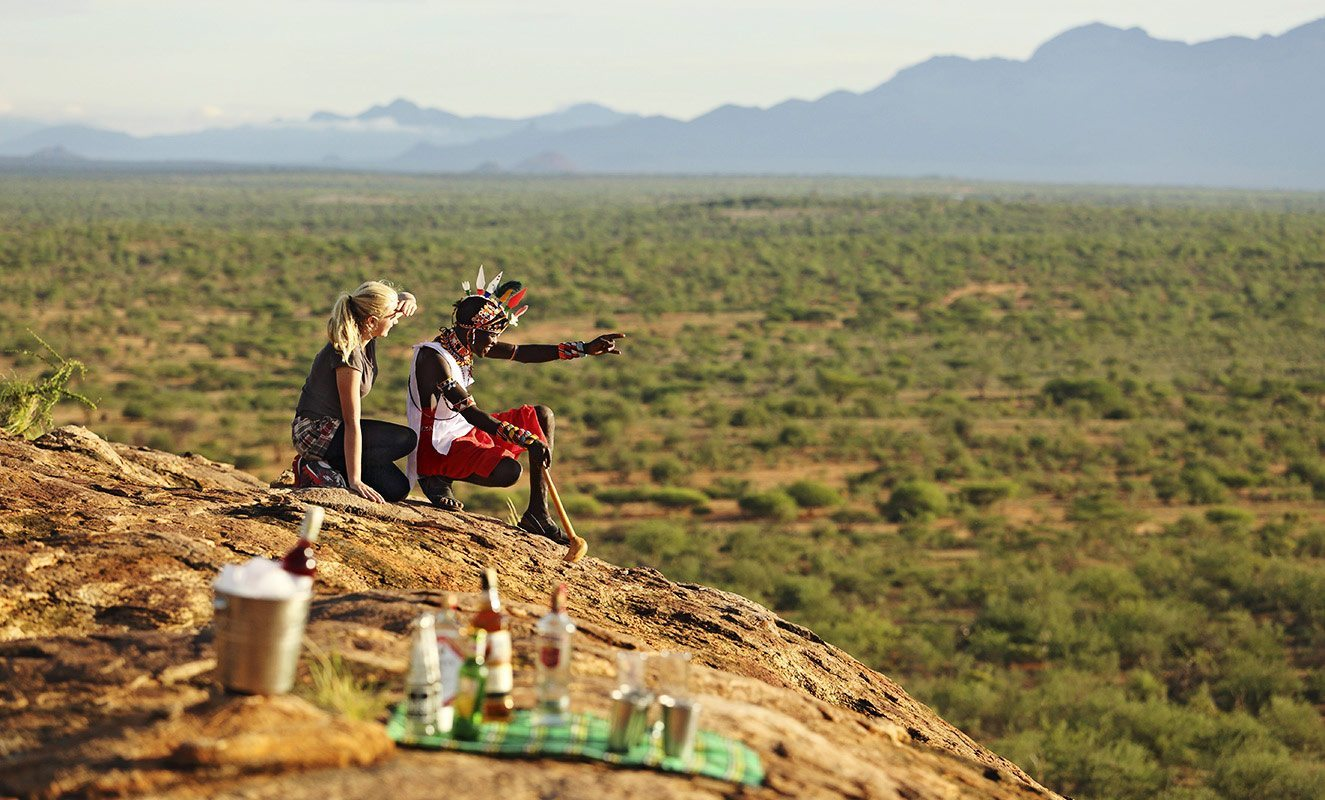 Sundowner Rock, near Sasaab, is the perfect spot to enjoy a drink and watch the light change. © The Safari Collection