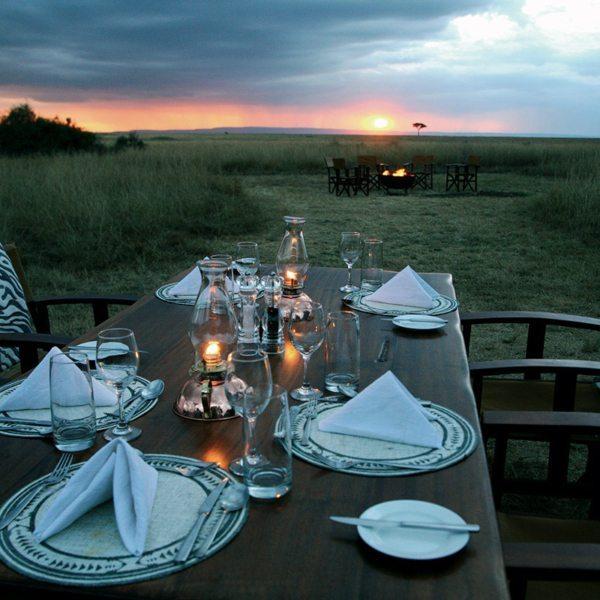 You can dine al fresco at Mara Plains Camp, while the sun sets over the Masai Mara. © Great Plains Conservation