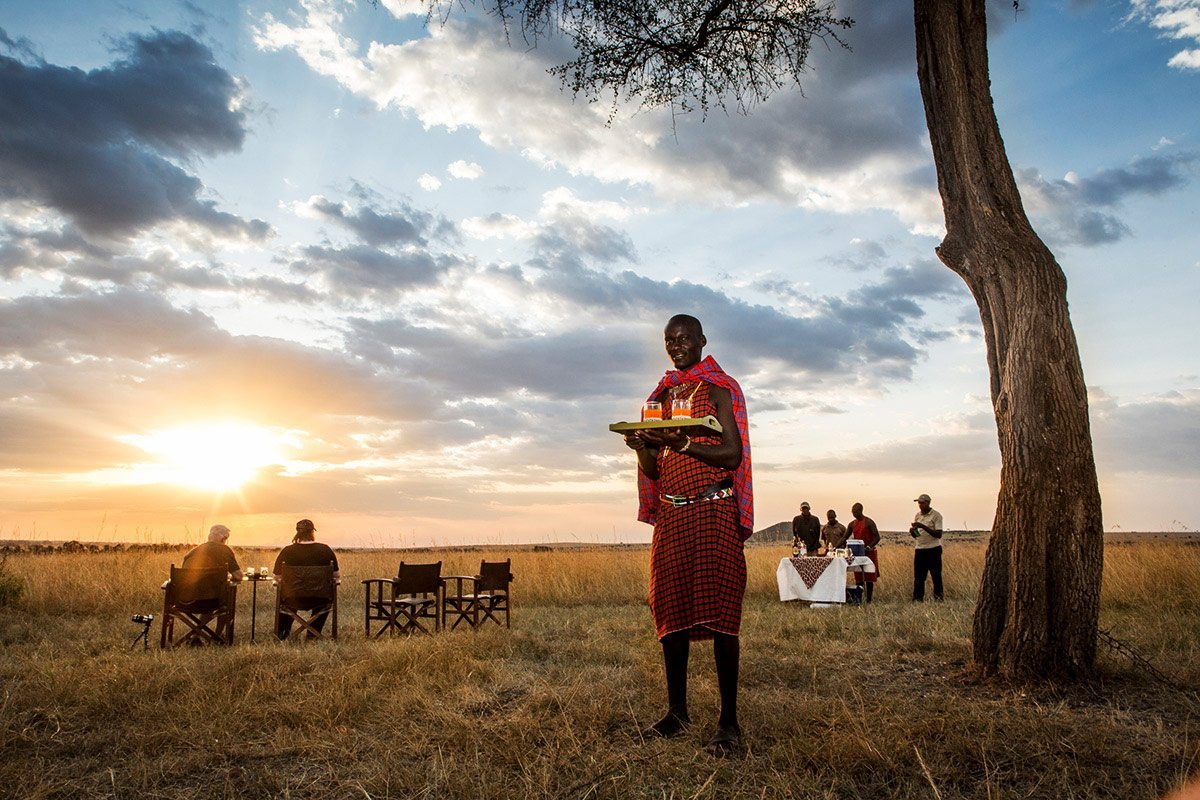 Sip on sundowners at Sala's Camp while the sun sets over the Masai Mara. © The Safari Collection