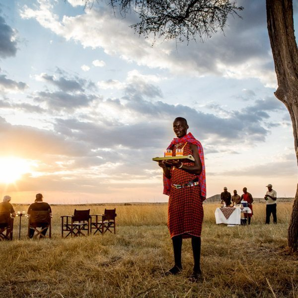 Sip on sundowners at Sala's Camp while the sun sets over the Masai Mara. © The Safari Collection