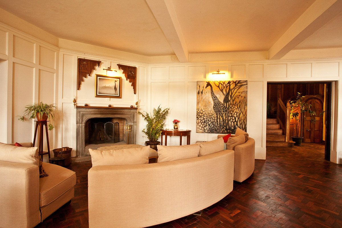 Giraffe Manors Living Room Has Lovely Parquet Floors And A Large Fireplace C Manor