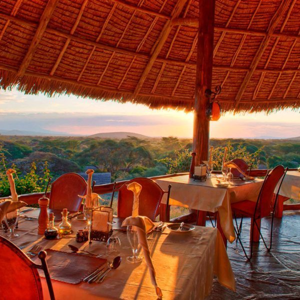 The sunny dining area at Tortilis Camp Amboseli comes with glorious views. © Elewana Collection