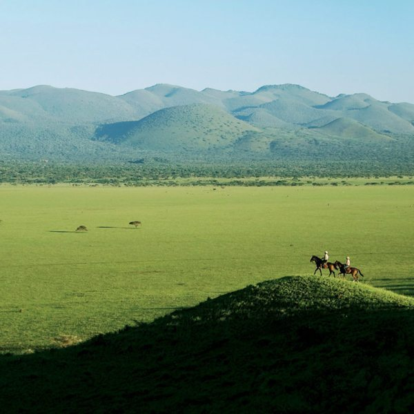 You can get a real sense of the vastness of the northern Kenyan wilderness during horseback safaris. © Great Plains Conservation