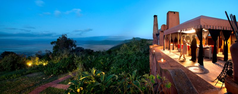 Have a pre-dinner drink while taking in the evening views of the caldera at Ngorongoro Crater Lodge.