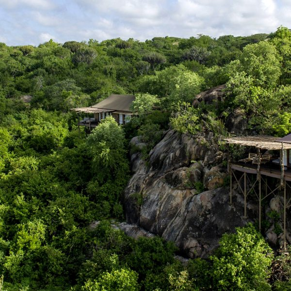 The tented suites at Mwiba Lodge are tucked among boulders overlooking a river gorge.