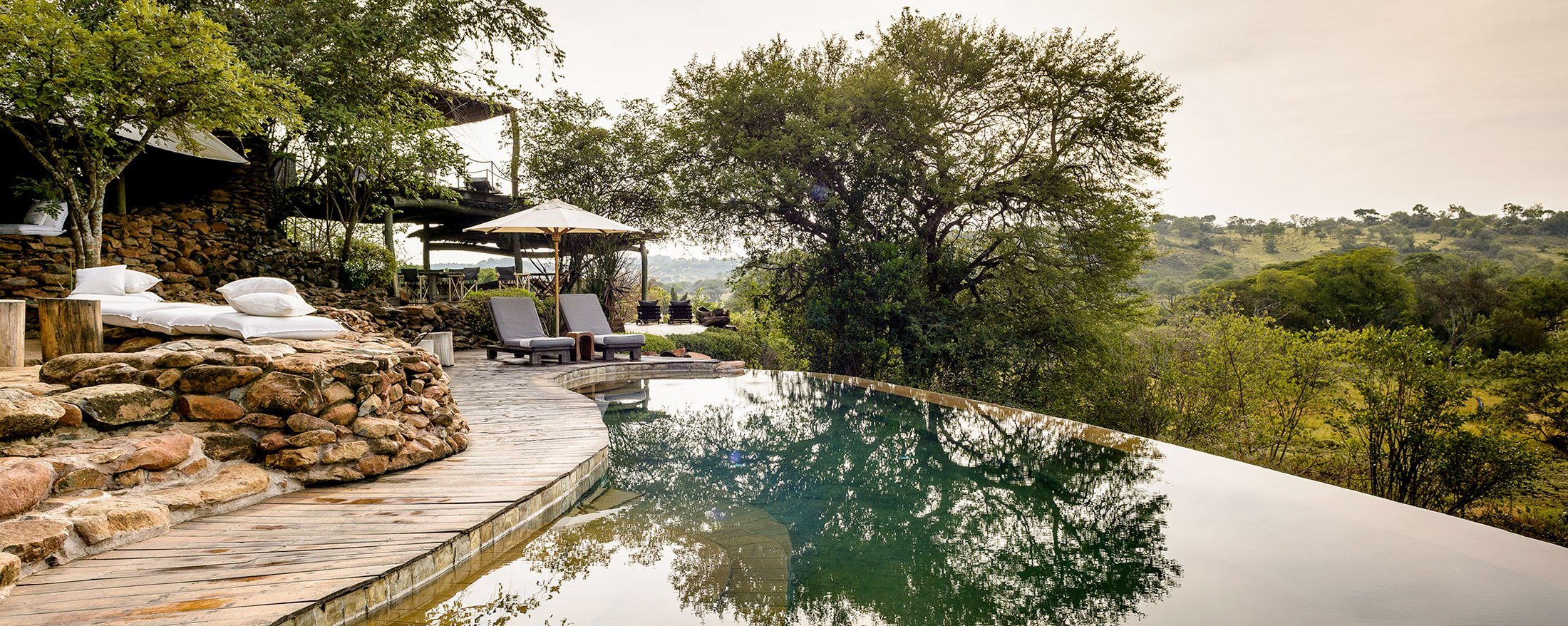 Lie next to one of the infinity pools at Faru Faru Lodge and take in sweeping views of the Grumeti Reserves.