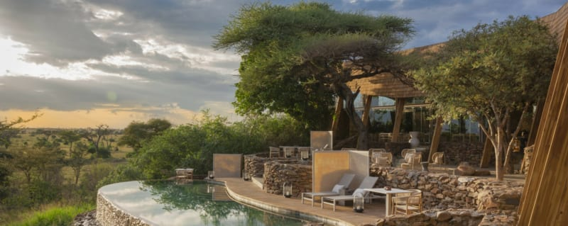 Faru Faru Lodge is constructed from natural materials, like rock and wood. © Singita