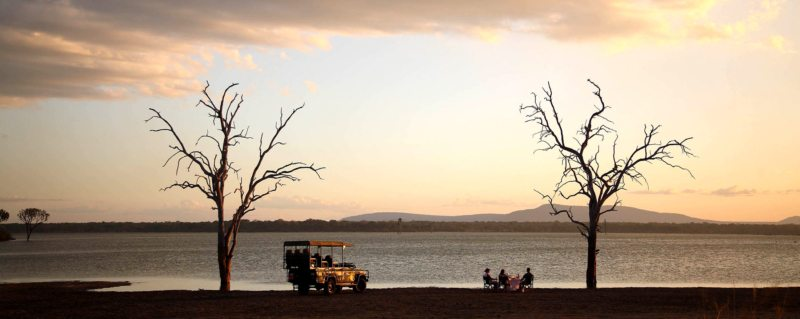 Rufiji River boat safari | Have sundowners next to the water in the Selous Game Reserve.