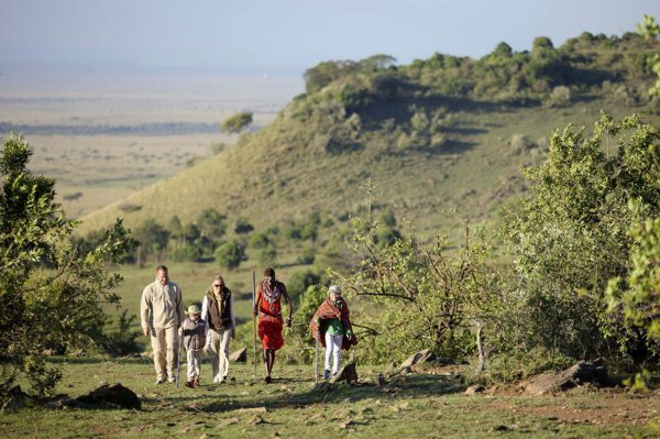A guided walking safari in the Masai Mara gives you a chance to stretch your legs. © &Beyond
