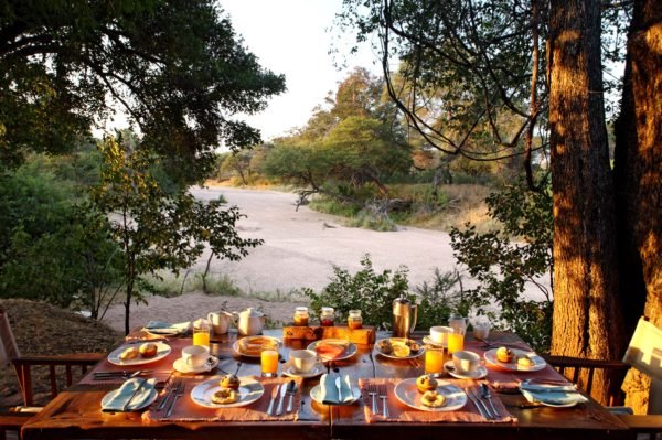 Enjoy breakfast under the trees at Jongomero. © Selous Safari Company