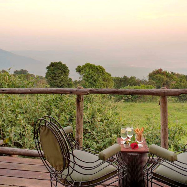 Your private balcony at Ngorongoro Crater Lodge overlooks the (sometimes misty) caldera. © &Beyond