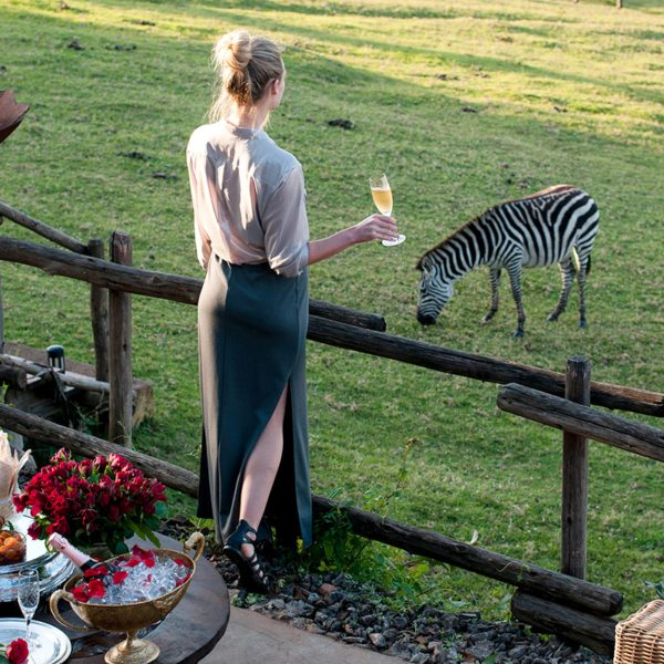 Drink a toast to the local wildlife when staying at Ngorongoro Crater Lodge. © &Beyond