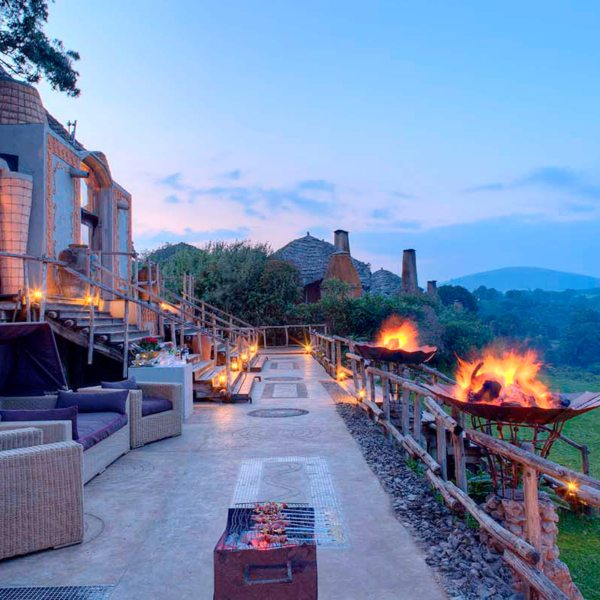 Roaring outdoor fires will keep you warm while you sip on evening drinks, and take in the view, at Ngorongoro Crater Lodge. © &Beyond