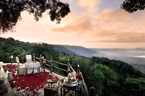 Go all out with a private rose-petal dinner at Ngorongoro Crater Lodge. © &Beyond