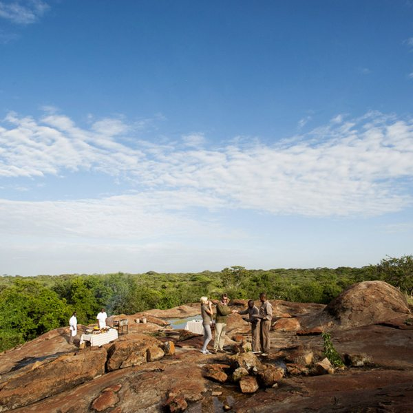 Enjoy bush dining on the rocks when staying at Mwiba Lodge. © Legendary Expeditions