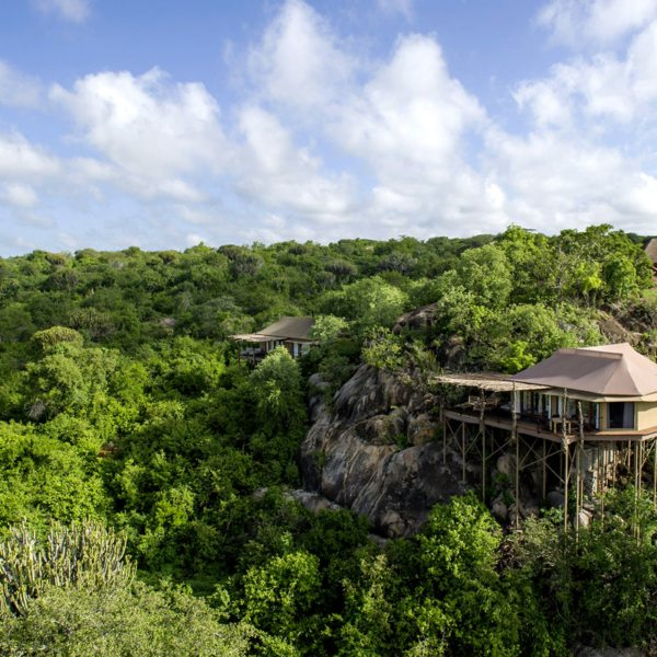 The tented suites at Mwiba Lodge are tucked among boulders overlooking a river gorge. © Legendary Expeditions