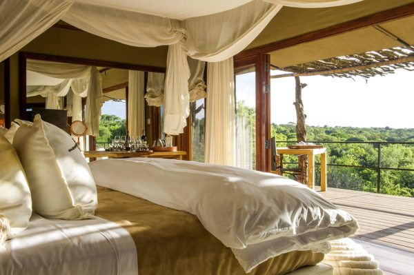Take in glorious Serengeti views right from your king-sized bed at Mwiba Lodge. © Legendary Expeditions