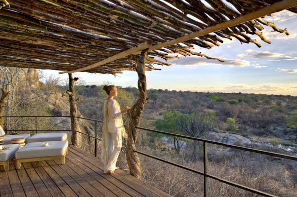 The tented suites at Mwiba Lodge have private decks overlooking the river. © Legendary Expeditions