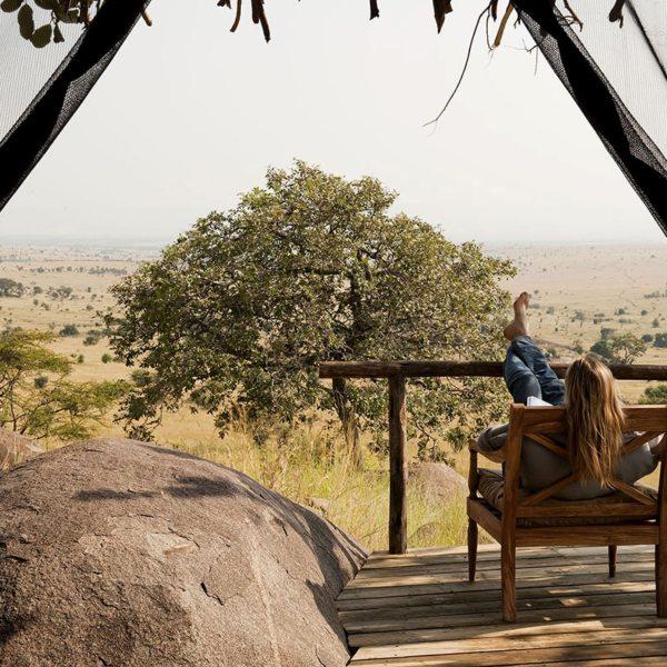 Kick back on your private porch at Lamai Serengeti and soak up the views. © Nomad Tanzania
