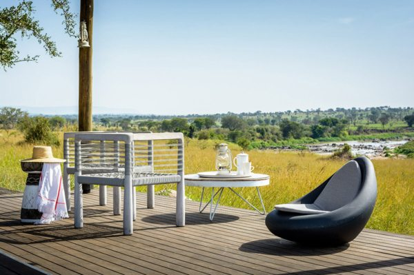You can watch the Mara River from your private deck when staying at Mara River Tented Camp. © Singita