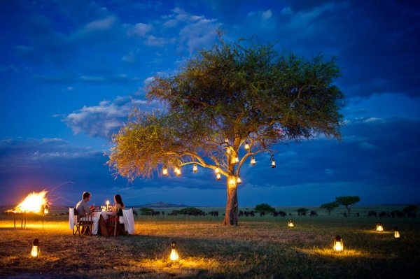 You'll love dining under the African night sky at Sabora Tented Camp. © Singita