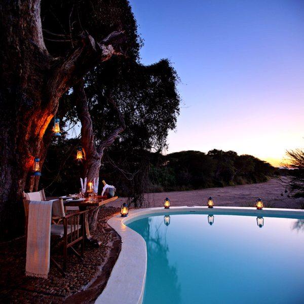 You can enjoy poolside dining at Jongomero. © Selous Safari Company