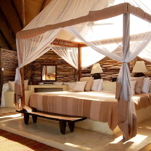 The hillside suites at Sand Rivers Selous have enormous beds. © Nomad Tanzania