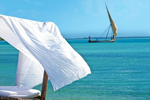 Relax on a seaside sunbed at Kilindi Zanzibar. © Elewana Collection