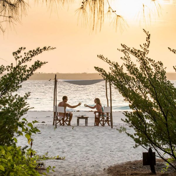 You'll want to toast to your Mnemba Island escape. © &Beyond