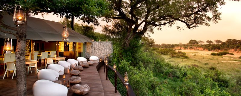 Comfortable egg chairs invite lazy afternoons watching wildlife right from the guest deck at Ngala Tented Camp.