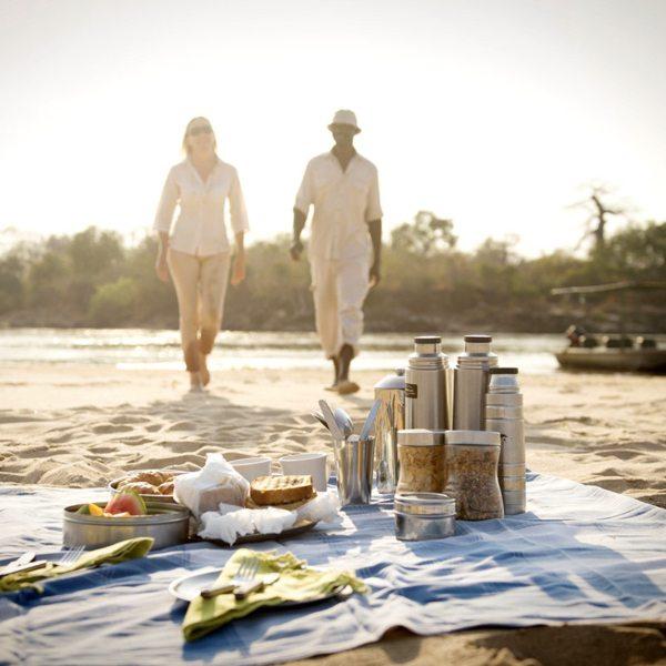 Enjoy a picnic on the riverbank at Sand Rivers Selous. © Nomad Tanzania