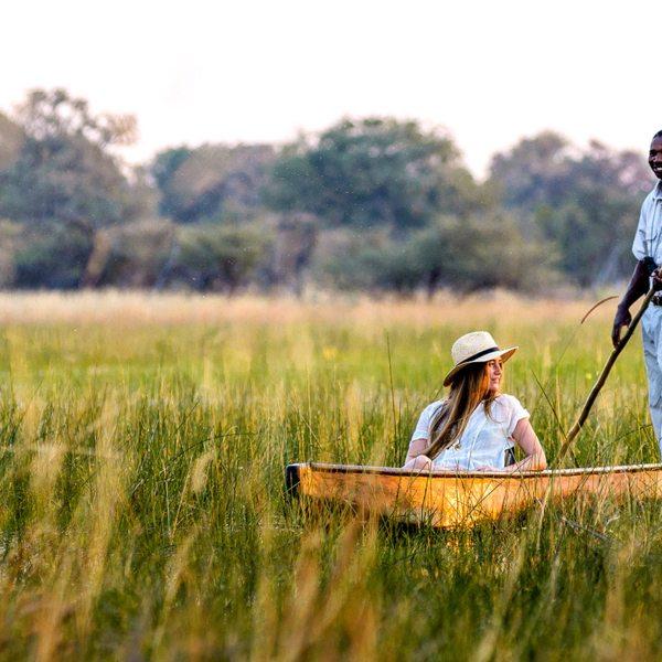 Relax as your guide navigates your mokoro safari through the Okavango Delta.