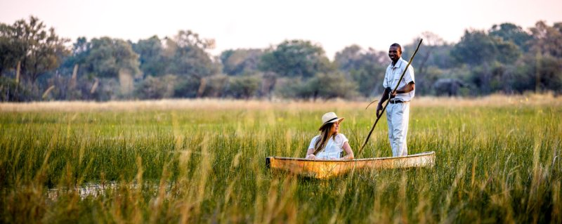 Relax as your guide navigates your mokoro safari through the Okavango Delta.
