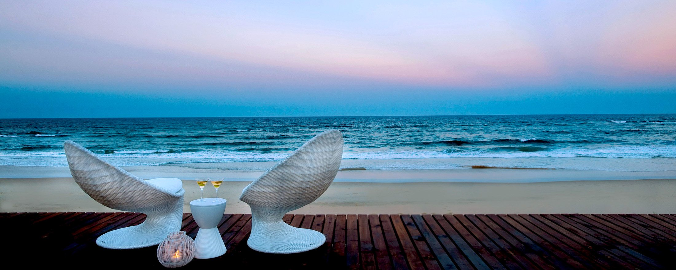 Sip on cocktails while you watch the sun set over the Indian Ocean at White Pearl Mozambique.