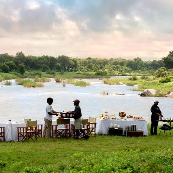 Stop for an alfresco meal during your game drive from Ivory Lodge.