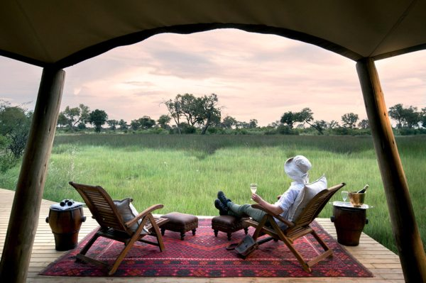 Soak up the view from your private verandah at Duba Explorers Camp. © Great Plains Conservation