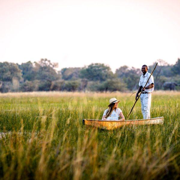 Relax as your guide navigates your mokoro through the Okavango Delta. © Sanctuary Retreats