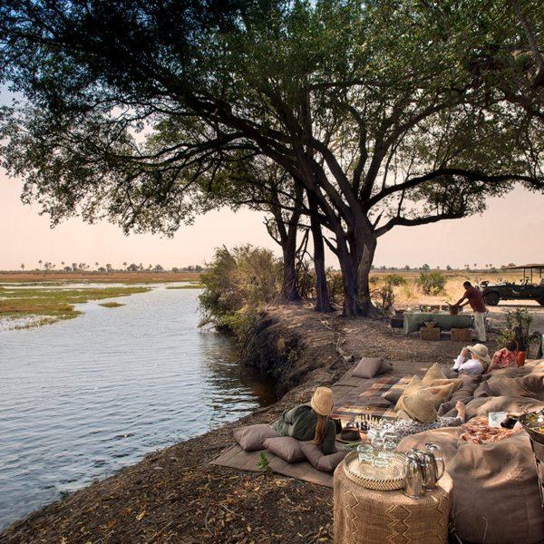Enjoy a lazy picnic near Sandibe Okavango Safari Lodge. © &Beyond