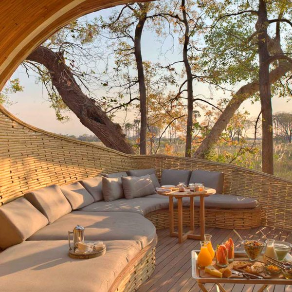 Dine alfresco at Sandibe Okavango Safari Lodge. © &Beyond